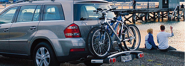 Bike carrier attached to car by a lake